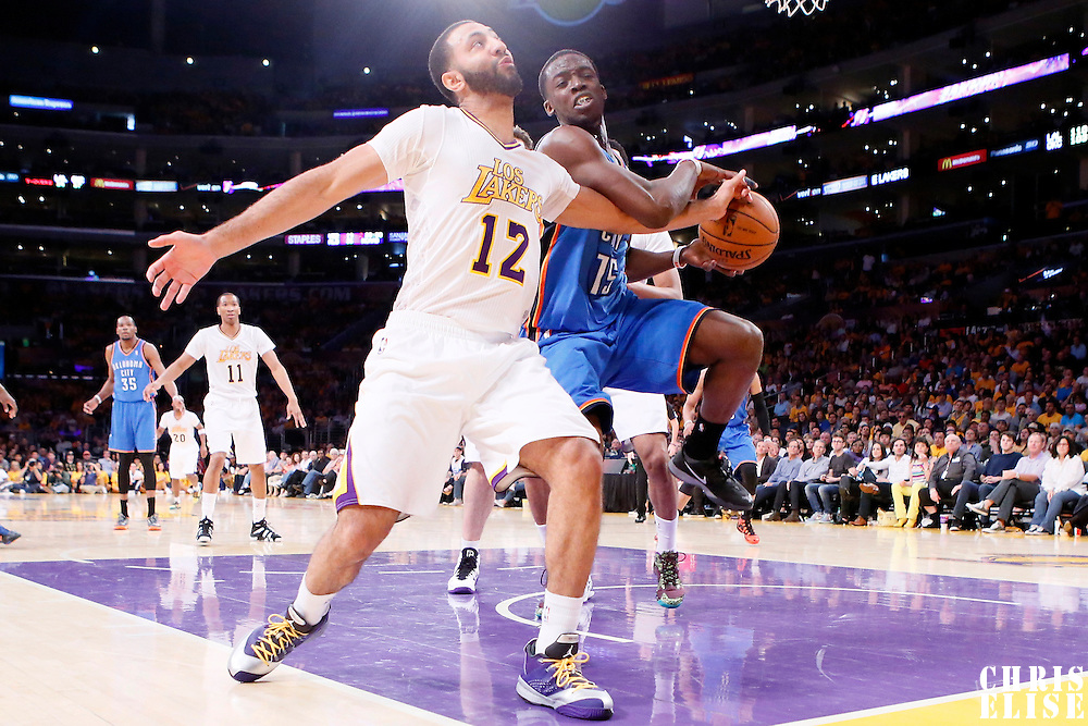 09 March 2014: Los Angeles Lakers point guard Kendall Marshall (12) vies for the ball with Oklahoma City Thunder point guard Reggie Jackson (15) during the Los Angeles Lakers 114-110 victory over the Oklahoma City Thunder at the Staples Center, Los Angeles, California, USA.