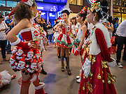 17 SEPTEMBER 2015 - BANGKOK, THAILAND:  Participants in the Santa pageant relax backstage at the World Santa Claus Congress. Twenty-six Santa Clauses from around the world are in Bangkok for the first World Santa Claus Congress. The World Santa Claus Congress has been an annual event in Denmark since 1957. This year's event, hosted by Snow Town, a theme park with a winter and snow theme, hosted the event. There were Santas from Japan, Hong Kong, the US, Canada, Germany, France and Denmark. They presented gifts to Thai children and judged a Santa pageant. Thailand, a Buddhist country, does not celebrate the religious aspects of Christmas, but Thais do celebrate the commercial aspects of the holiday.   PHOTO BY JACK KURTZ