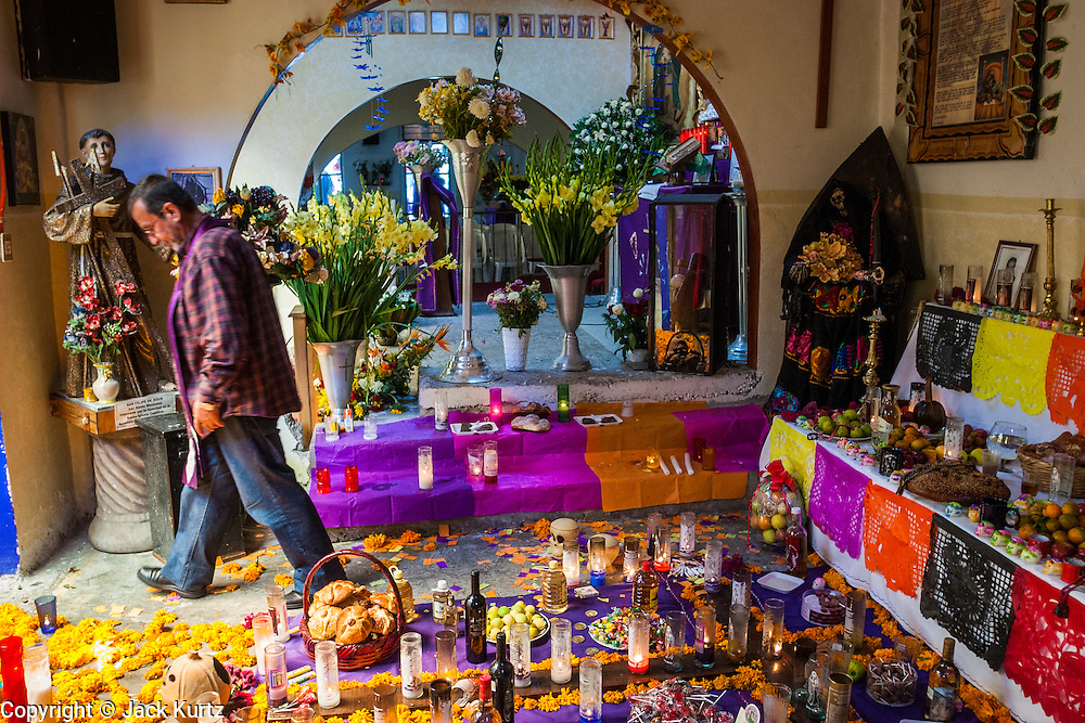 MEXICO CITY, MEXICO:  A priest leaves a shrine to Santa Muerte (St. Death) in Iglesia de la Piedad (Mercy Church) in the Tepito section of Mexico City. St. Death is venerated throughout Mexico and Mexican communities in the United States. The veneration of St. Death started in Mexico's prisons about 10 years and has since spread through working class neighborhoods in many Mexican cities. The worship of St. Death was recognized as an official by the Mexican government in 2003. The Catholic Church in Mexico is opposed to the worship of St. Death and has held rallies and prayer vigils against the Saint. The small church in Tepito is frequently swamped with visitors and the religion has spread quickly through the tough, drug and crime plagued neighborhood, widely considered the most lawless in Mexico City.    PHOTO BY JACK KURTZ