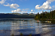 Kayakers on Whitefish Lake with Big Mountain and F.H. Stoltze Land & Lumber Co. property in the background. Whitefish, Montana