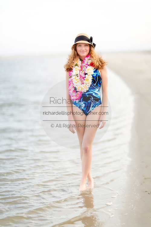 Beautiful strawberry blond woman at the beach on Sullivan's Island, South Carolina.