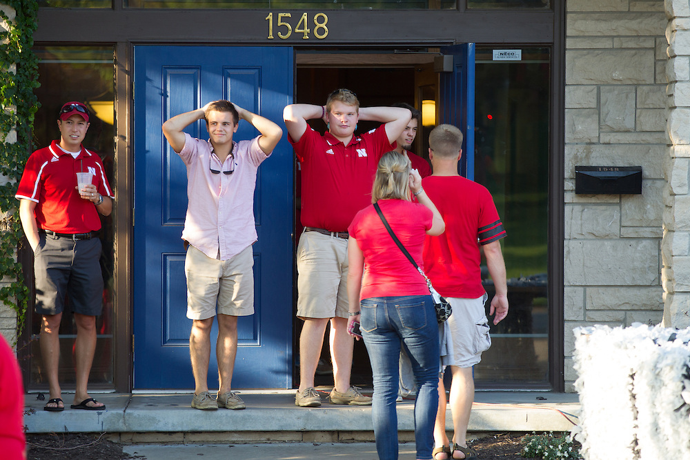 UNL Students react to seeing their homecoming display destroyed after falling from the wind.