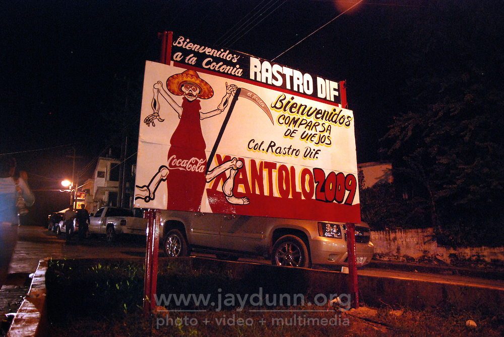 """MEXICO, Veracruz, Tantoyuca, Oct 27- Nov 4, 2009. Sign for the 2009 """"Xantolo"""" in a Tantoyuca neighborhood. """"Xantolo,"""" the Nahuatl word for """"Santos,"""" or holy, marks a week-long period during which the whole Huasteca region of northern Veracruz state prepares for """"Dia de los Muertos,"""" the Day of the Dead. For children on the nights of October 31st and adults on November 1st, there is costumed dancing in the streets, and a carnival atmosphere, while Mexican families also honor the yearly return of the souls of their relatives at home and in the graveyards, with flower-bedecked altars and the foods their loved ones preferred in life. Photographs for HOY by Jay Dunn."""