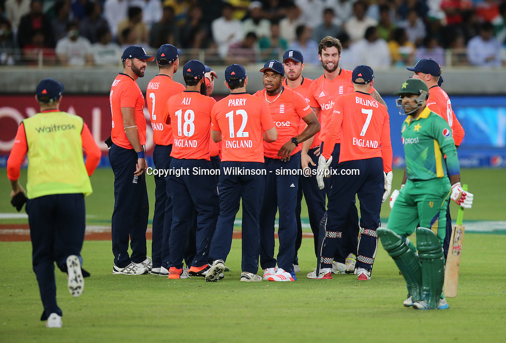 PICTURE BY MARK GREEN/SWPIX.COM  Pakistan v England 1st T20, Dubai Internayional Stadium, UAE, 26/11/15 <br /> England celebrate the dismissal of Pakistan's Sarfraz Ahmed