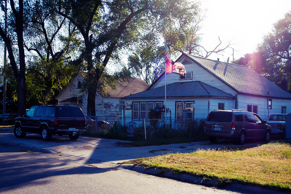 A Huskers flag catches some late evening sun rays over a house in North Platte, NE.