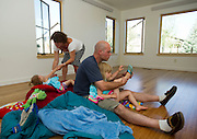 PRICE CHAMBERS / NEWS&amp;GUIDE<br /> Jim and Lisa Wolfgang get their daughters ready atop a pile of sleeping bags, all they needed on the first night before moving in furniture the next morning.