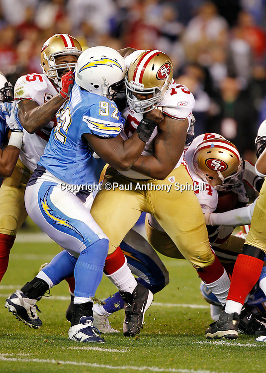 San Francisco 49ers offensive tackle Anthony Davis (76) and San Francisco 49ers tight end Vernon Davis (85) double team block San Diego Chargers defensive end Vaughn Martin (92) during the NFL week 15 football game against the San Diego Chargers on Thursday, December 16, 2010 in San Diego, California. The Chargers won the game 34-7. (©Paul Anthony Spinelli)