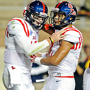 Mississippi tight end Evan Engram (17) celebrates with quarterback Bo Wallace (14) after Wallace's touchdown during the first half of an NCAA college football game in College Station, Texas, Saturday, Oct. 11, 2014. (Photo/Thomas Graning)