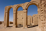 The remains of mud brick arches and Christian tombs at Al-Bagawat Coptic necropolis, al-Kharga, Western Desert, Egypt. Al-Bagawat, (also, El-Bagawat) one of the oldest and best preserved ancient Christian cemeteries in the world, which functioned at the Kharga Oasis in southern-central Egypt from the 3rd to the 7th century AD. Coptic frescoes of the 3rd to the 7th century are found on the walls and there are 263 funerary chapels of which the Chapel of Exodus (5th or 6th century) and Chapel of Peace (of mid 4th century) have frescoes.