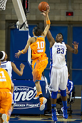 UK forward/center Samarie Walker, right contests a shot by Tennessee guard Meighan Simmons in the second half. The University of Kentucky Women's Basketball team hosted Tennessee , Sunday, March 03, 2013 at Memorial Coliseum in Lexington . Photo by Jonathan Palmer
