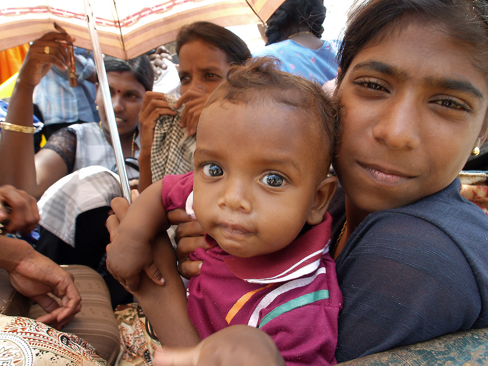 At a camp for Internally displaced people in Vakarai,  Batticaloa district of Srilanka. War had just ended and people who had ran away were being asked to come back. The area was still heavily mined and army suspected that snipers were around. This was photographed in 2007, while on the story - 'When the Suicide Bomber Is a Woman' for Marie Claire.