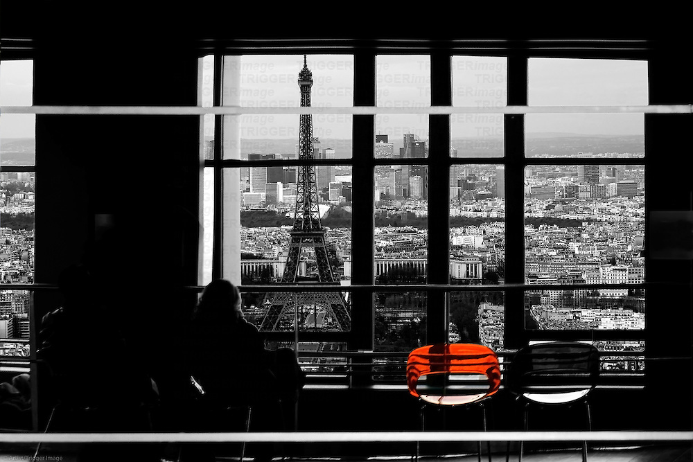 The montage of the Eiffel Tower and the skyline of Paris behind a window where people sitting.
