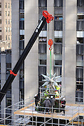 IN THIS IMAGE DISTRIBUTED FOR SWAROVSKI -  For the 10th year, the Swarovski Star is raised to the top of the 76-foot Rockefeller Center Christmas tree, Thursday, Nov. 14, 2013, in New York.  The Star, features 25,000 crystals and weighs 550 pounds, will sit atop the Rockefeller Center Christmas tree which will be lit on Dec. 4th.    (Diane Bondareff/Invision for Swarovski/AP Images)