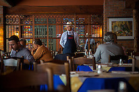 Medellin, Colombia- March 16, 2015: A waiter surveys the room at Hato Viejo. The restaurant, which sits a few stairs above the chaos of downtown Medellin streets, and has become a fixture over the past 30 years serving traditional paisa cusine. CREDIT: Chris Carmichael for The New York Times