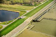Nederland, Zeeland, Gemeente Reimerswaal, 01-04-2016; Bathse spuisluis en Bathse spuikanaal en zeedijk Westerschelde (in de voorgrond).<br /> Spuikanaal en spuisluis maken deel uit van de zoetwaterhuishouding van het Zoommeer en behoren tot de Deltawerken.<br /> Sluice and drainage canal, part of the fresh water management works, build as part of the Delta Works.<br /> <br /> luchtfoto (toeslag op standard tarieven);<br /> aerial photo (additional fee required);<br /> copyright foto/photo Siebe Swart