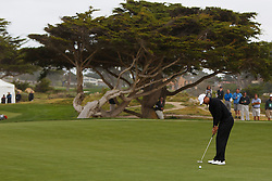 Feb 10, 2012; Pebble Beach CA, USA; Tiger Woods putts on the eighth hole during the second round of the AT&T Pebble Beach Pro-Am at Monterey Peninsula Country Club. Mandatory Credit: Jason O. Watson-US PRESSWIRE
