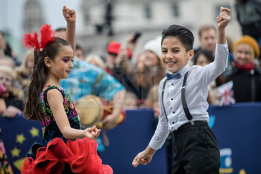 © Licensed to London News Pictures. 30/12/2018. London, UK. Two young dancers from Carnaval Del Pueblo, a dance group from across Latin America, performs at a preview ahead of the London New Year's Day Parade. More than 8,000 performers from 26 countries will take part in the parade on 1st January 2019. Photo credit: Rob Pinney/LNP