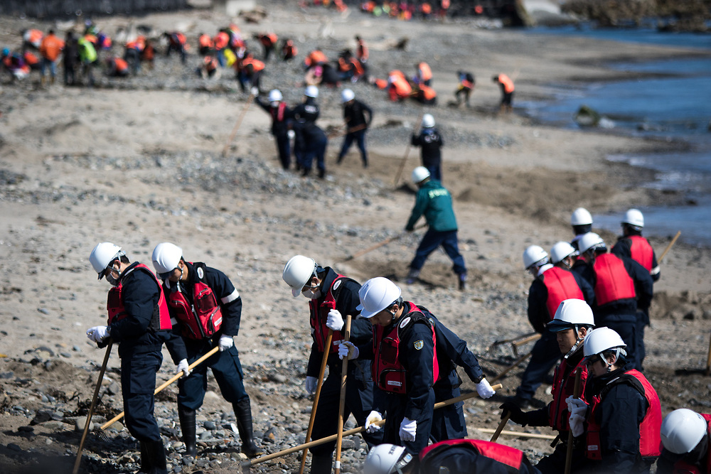 KESENNUMA, JAPAN - MARCH 11: Police officers search for the remains of people still unaccounted for in the wake of the March 11, 2011 earthquake and tsunami, on the coast of Kesennuma, Miyagi Prefecture on March 11, 2017. On this day Japan marks the sixth anniversary of a devastating earthquake and tsunami that hit on March 11, 2011 and left nearly 19,000 people dead or missing, turned coastal communities into wasteland and triggered a nuclear crisis. (Photo: Richard Atrero de Guzman/ANADOLU Agency)