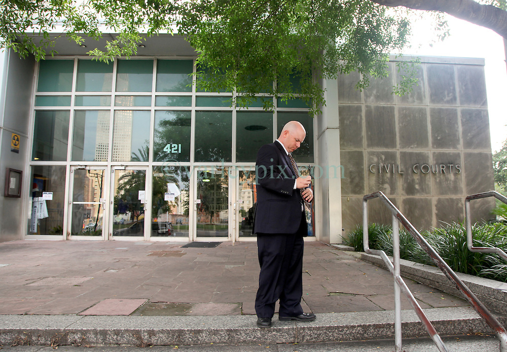 01 June  2015. New Orleans, Louisiana. <br /> L/R/ Ryan LeBlanc stands alone outside Civil Distrcit Court where he and his mother Renee and sister Rita Benson LeBlanc attended a hearing to determine the competency of grandfather/father Tom Benson. Benson is the billionaire owner of the NFL New Orleans Saints, the NBA New Orleans Pelicans, various Mercedes dealerships, banks, property assets and a slew of business interests. Rita, her brother and mother demanded a competency hearing after Benson changed his succession plans and decided to leave the bulk of his estate to third wife Gayle, sparking a controversial fight over control of the Benson business empire.<br /> Photo&copy;; Charlie Varley/varleypix.com