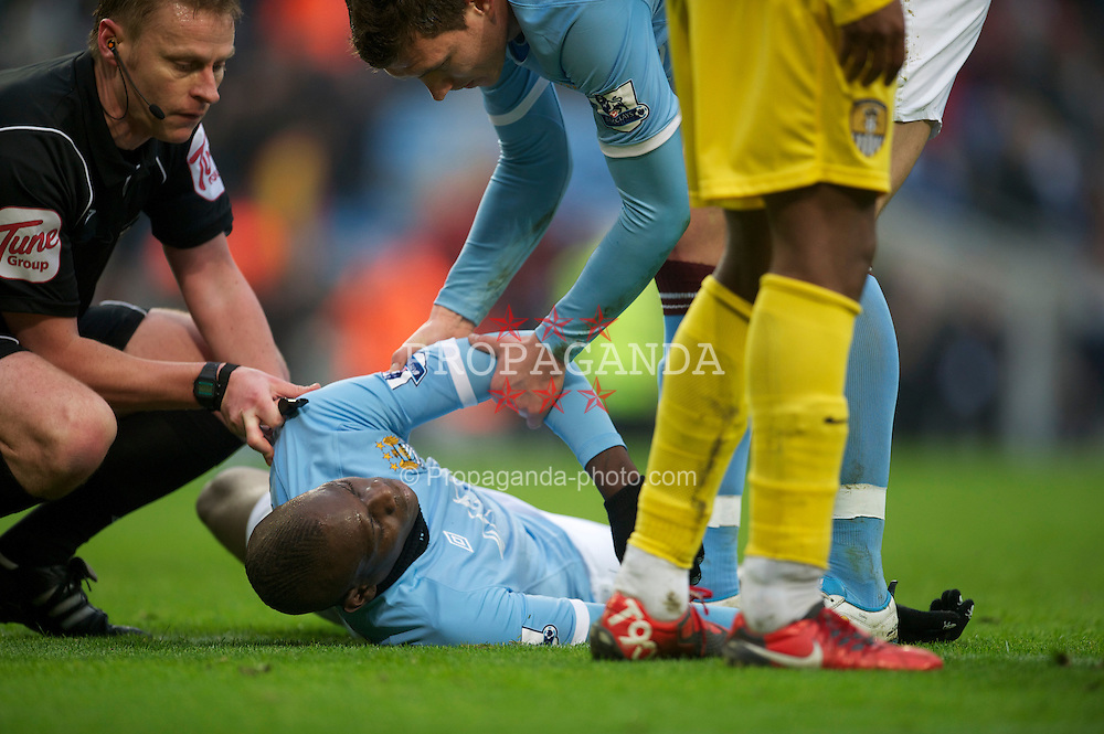 MANCHESTER, ENGLAND - Sunday, February 20, 2011: Manchester City's Mario Balotelli lies injured during the FA Cup 4th Round Replay match against Notts County at the City of Manchester Stadium. (Photo by David Rawcliffe/Propaganda)