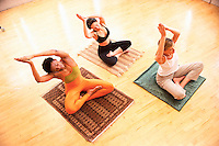 Women Doing Yoga in Class --- Image by © Jim Cummins/CORBIS