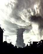 Tornado striking a town in the Mid-West of the USA, 1930s.
