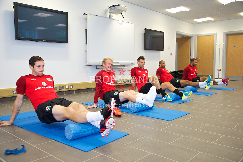 NEWPORT, WALES - Monday, August 12, 2013: Wales players Andrew Crofts, Jonathan Williams, Joe Ledley, captain Ashley Williams and Craig Davies perform 'pre-activation' inside during training at the FAW National Development Centre at Dragon Park ahead of the International friendly against the Republic of Ireland. (Pic by David Rawcliffe/Propaganda)