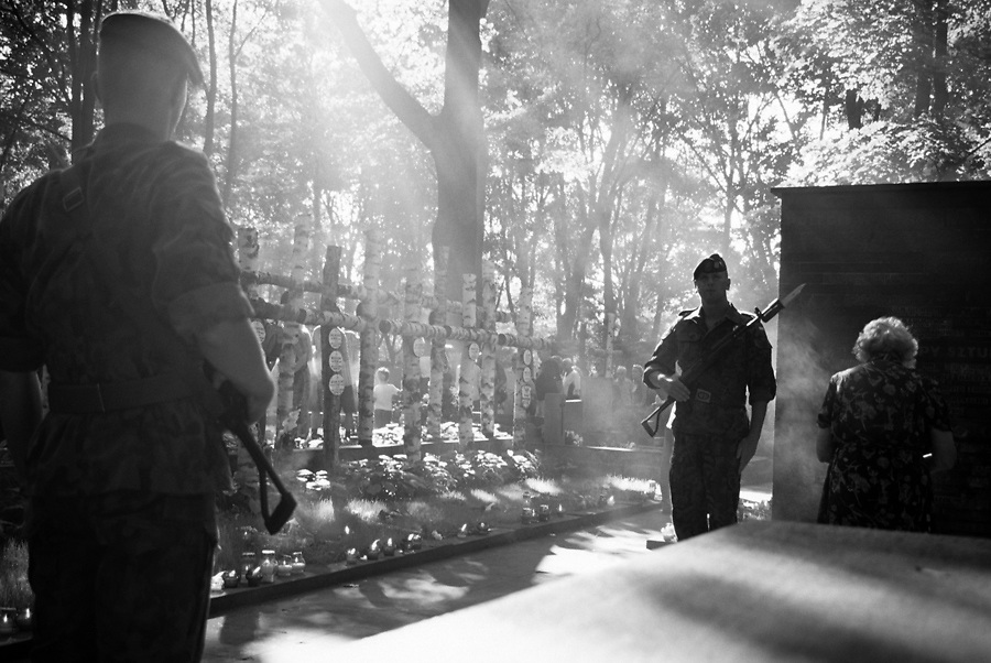 Guard of honour in Powazki Military cemetery, Warsaw. The white wooden crosses are the tombs of the insurgents of Warsaw 1944 Uprising.