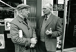 Two men chatting in the street, Nottingham UK 1989