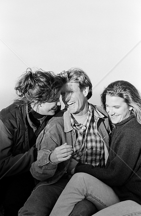 Three friends smiling and enjoying a moment together