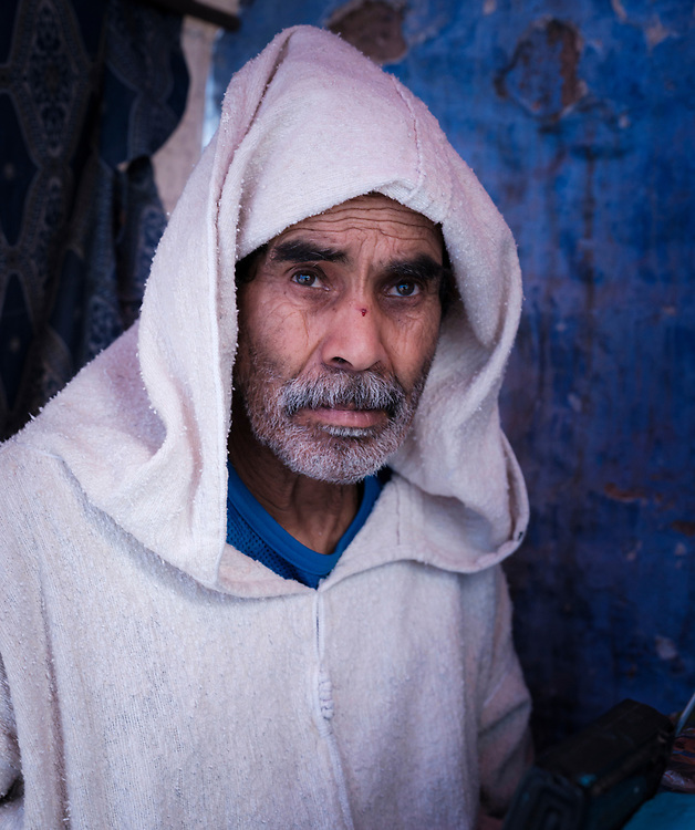 CHEFCHAOUEN, MOROCCO - CIRCA APRIL 2017: Portrait of Moroccan man in the streets of Chefchaouen wearing a traditional djellaba