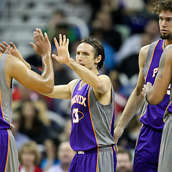 December 30, 2011; New Orleans, LA, USA; Phoenix Suns point guard Steve Nash (13) celebrates with teammates during the first half of a game against the New Orleans Hornets at the New Orleans Arena. The Suns defeated the Hornets 93-78.   Mandatory Credit: Derick E. Hingle-US PRESSWIRE