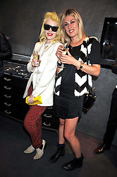 Left to right, PAM HOGG and NATHALIE HARTLEY at a party to celebrate the new Stephen Webster store on Mount Street, London W1 followed by a dinner at Maddox, Mill Street, London on 24th June 2009.