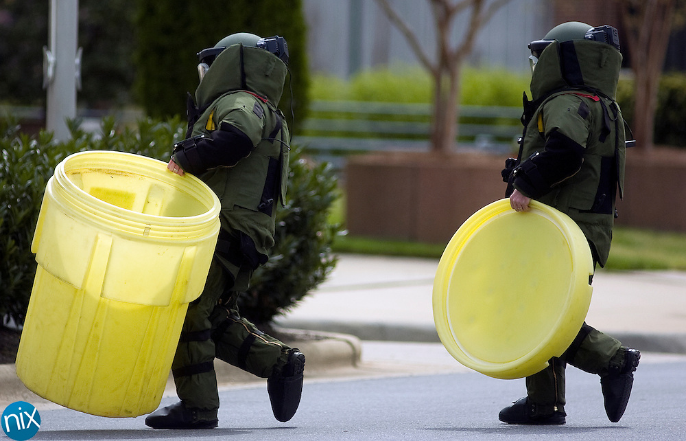 Two members of the Cabarrus County Sheriff's Bomb Squad investigate a suspicious package at the Cabarrus County Government Center Wednesday morning.