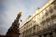 The Graben, one of Vienna's main shopping streets and pedestrian zone at the center. A dove flying away from the Pestsaeule.