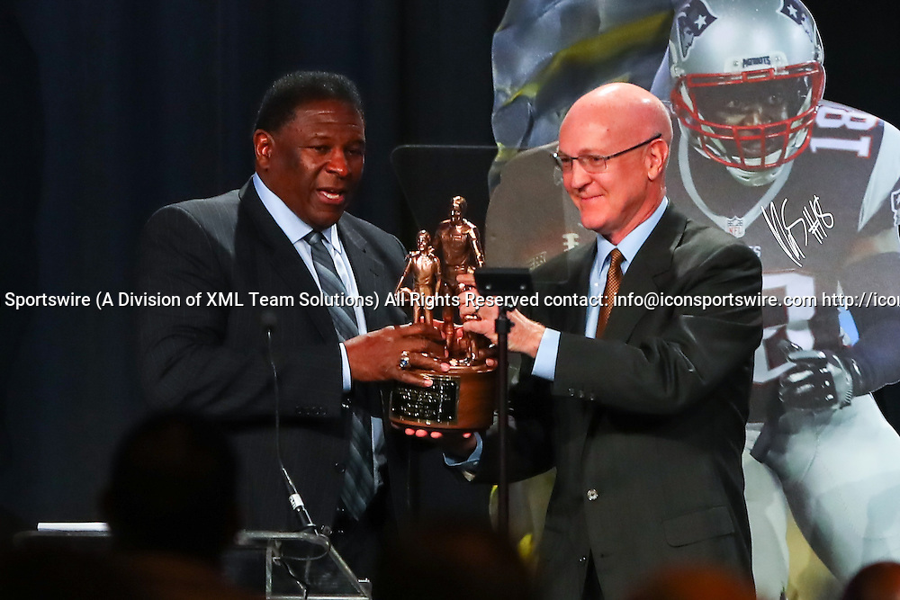 HOUSTON, TX - FEBRUARY 04:  NFL Hall of Famer Jackie Slater recieves the Bart Starr Award from Bart Starr Jr for his son New England Patriots wide receiver Matthew Slater during the Bart Starr Award Super Bowl Breakfast on February 04, 2017, at the Marriott Marquis in Houston, Texas.  (Photo by Rich Graessle/Icon Sportswire)