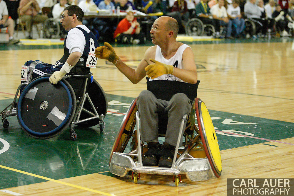 July 7th, 2006: Anchorage, AK - Michael Guilbault looks for the ball as White defeated Blue in the gold medal game of Quad Rugby at the 26th National Veterans Wheelchair Games.