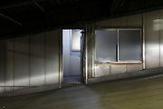 pedestrian door in a parking garage with head lights from a car