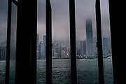 Hong Kong, China - General view shows a layer of fog descending upon buildings in the Wan Chai central district  of Hong Kong as ships sail in Victoria Harbour on May 03, 2018.