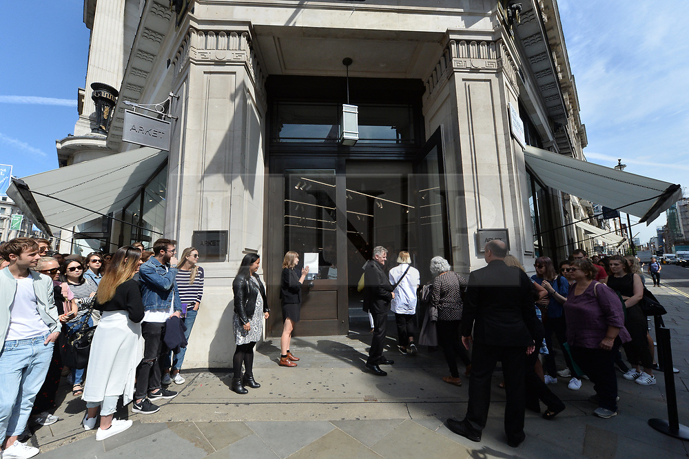 © Licensed to London News Pictures. 25/08/2017. London, UK. Customers enter the new opening of H&M group's first ARKET flagship store in Regent Street. ARKET has called itself a modern day market selling clothes, homeware as well as having a small cafe space. Photo credit: Ray Tang/LNP