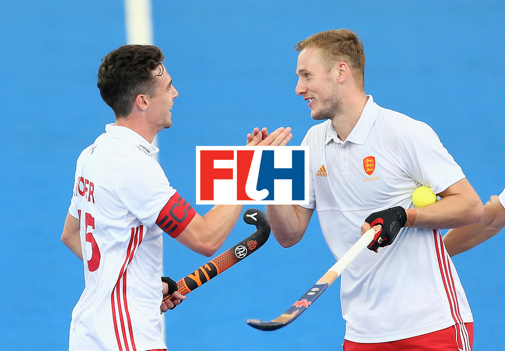 LONDON, ENGLAND - JUNE 25:  Phil Roper of England celebrates scoring their teams fourth goal with teammates during the 3rd/4th place match between Malaysia and England on day nine of the Hero Hockey World League Semi-Final at Lee Valley Hockey and Tennis Centre on June 25, 2017 in London, England.  (Photo by Steve Bardens/Getty Images)