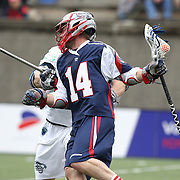 Ryan Boyle #14 of the Boston Cannons keeps the ball from a member of the Chesapeake Bayhawks during the game at Harvard Stadium on April 27, 2014 in Boston, Massachusetts. (Photo by Elan Kawesch)