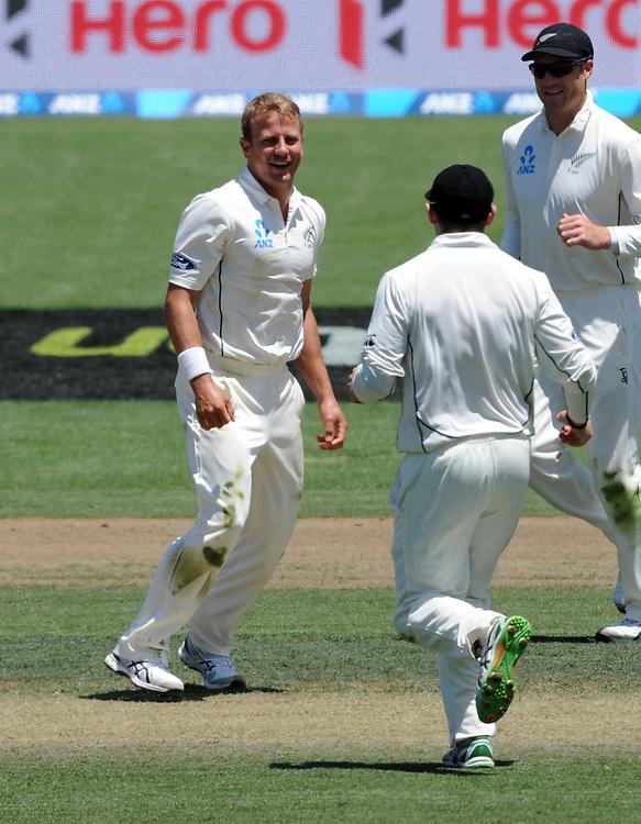 New Zealand's Neil Wagner, left, celebrates the wicket of Sri Lanka's Milinda Siriwardana or 26 on day three of the second International Cricket Test, Seddon Park, Hamilton, New Zealand, Sunday, December 20, 2015. Credit:SNPA / Ross Setford