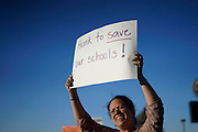 A protestor holds up a sign referring to a controversy with the local school board in Wheat Ridge, Colorado October 3, 2014. The question of how U.S. teens learn history in public schools is the latest flash point in a liberal-conservative fight over national curricula that had previously focused on more scientific topics such as teaching creationism versus evolution.  REUTERS/Rick Wilking (UNITED STATES)