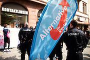 Frankfurt am Main | 26 Apr 2014<br /> <br /> Am Samstag (26.04.2014) veranstalten Aktivisten der rechtspopulistischen AfD (Alternative f&uuml;r Deutschland) auf der Leipziger Stra&szlig;e in Frankfurt-Bockenheim einen Infostand, sie versuchen, Infomaterial und Flugbl&auml;tter an Passanten zu verteilen, um f&uuml;r die Partei im laufenden Europawahlkampf zu werben.<br /> Die AfD-Wahlk&auml;mpfer werden durchgehend von etwa 50 linksradikalen Aktivisten gest&ouml;rt und behindert.<br /> hier: Der kleine Infostand der AfD muss dauerhaft von Polizeibeamten gesch&uuml;tzt werden. <br /> <br /> &copy;peter-juelich.com<br /> <br /> [No Model Release | No Property Release]