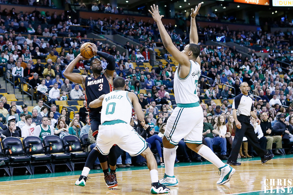 27 January 2013: Miami Heat shooting guard Dwyane Wade (3) looks to pass the ball over Boston Celtics point guard Avery Bradley (0) and Boston Celtics power forward Jared Sullinger (7) during the Boston Celtics 100-98  2OT victory over the Miami Heat at the TD Garden, Boston, Massachusetts, USA.