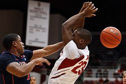 November 18, 2010; Stanford, CA, USA;  Virginia Cavaliers guard Jontel Evans (1) blocks a shot from Stanford Cardinal guard Gabriel Harris (23) during the first half at Maples Pavilion.