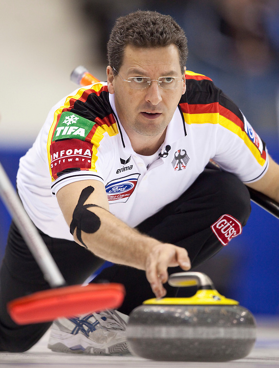 German skip Andy Kapp delivers a stone during his match against the Czech Republic at the World Curling Championships at the Brandt Centre in Regina, Saskatchewan, April 7, 2011.<br /> AFP PHOTO/Geoff Robins