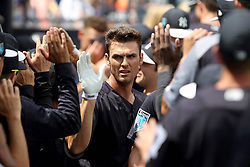 March 18, 2018 - Tampa, FL, U.S. - TAMPA, FL - MAR 18: Greg Bird (33) of the Yankees is congratulated by team mates upon scoring a run during the game between the Miami Marlins and the New York Yankees on March 18, 2018, at George M. Steinbrenner Field in Tampa, FL. (Photo by Cliff Welch/Icon Sportswire) (Credit Image: © Cliff Welch/Icon SMI via ZUMA Press)