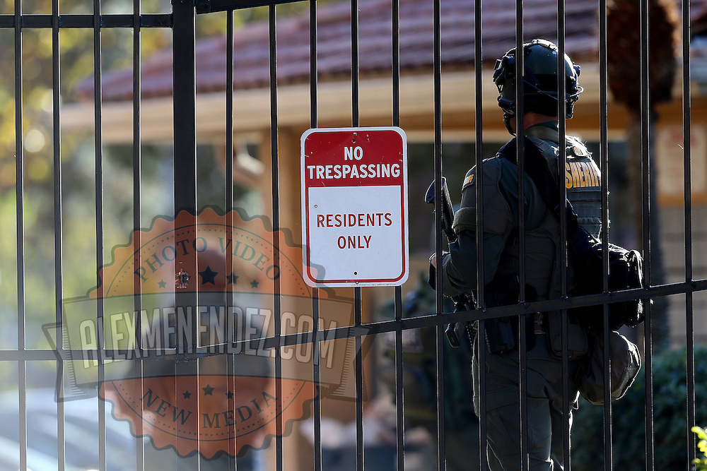 Law enforcement officers are seen as they prepare to search for suspect Markeith Loyd at the Tzadik Brookside Apartments on January 9 2017 in Orlando, Florida. Loyd shot an Orlando Police officer earlier in the day at a local Walmart, the officer has since died.  (Alex Menendez via AP)